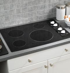 Brand: GE, Model: JP346CMCC, Style: Black Surface with White Accents