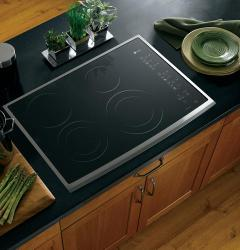 Brand: General Electric, Model: PP950WMWW, Color: Black Surface with Stainless Steel Trim